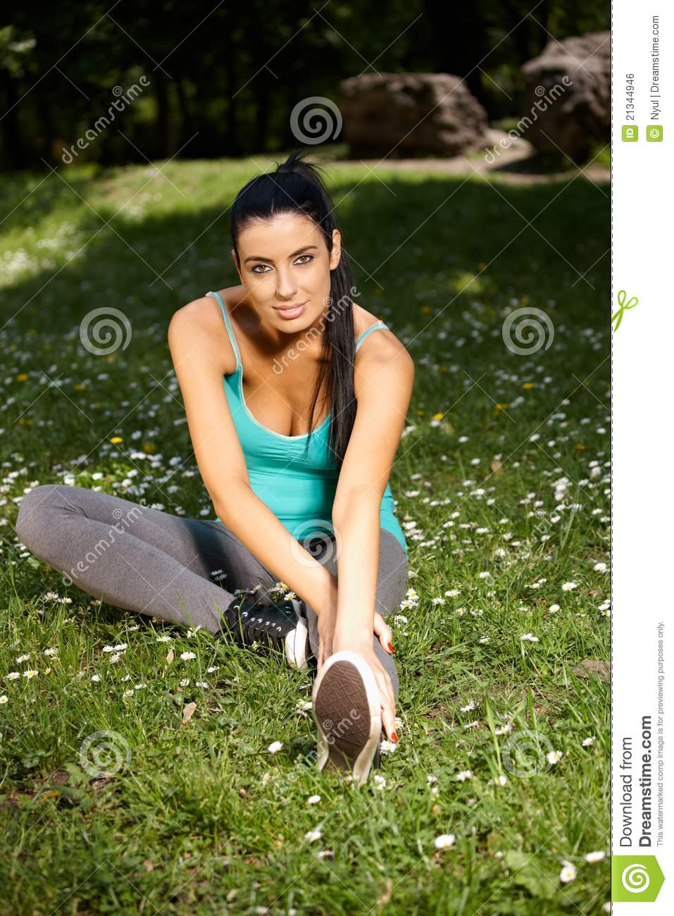 Pretty woman exercising in citypark smiling