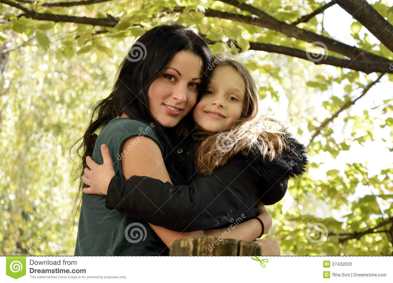 Pretty woman and girl autumn