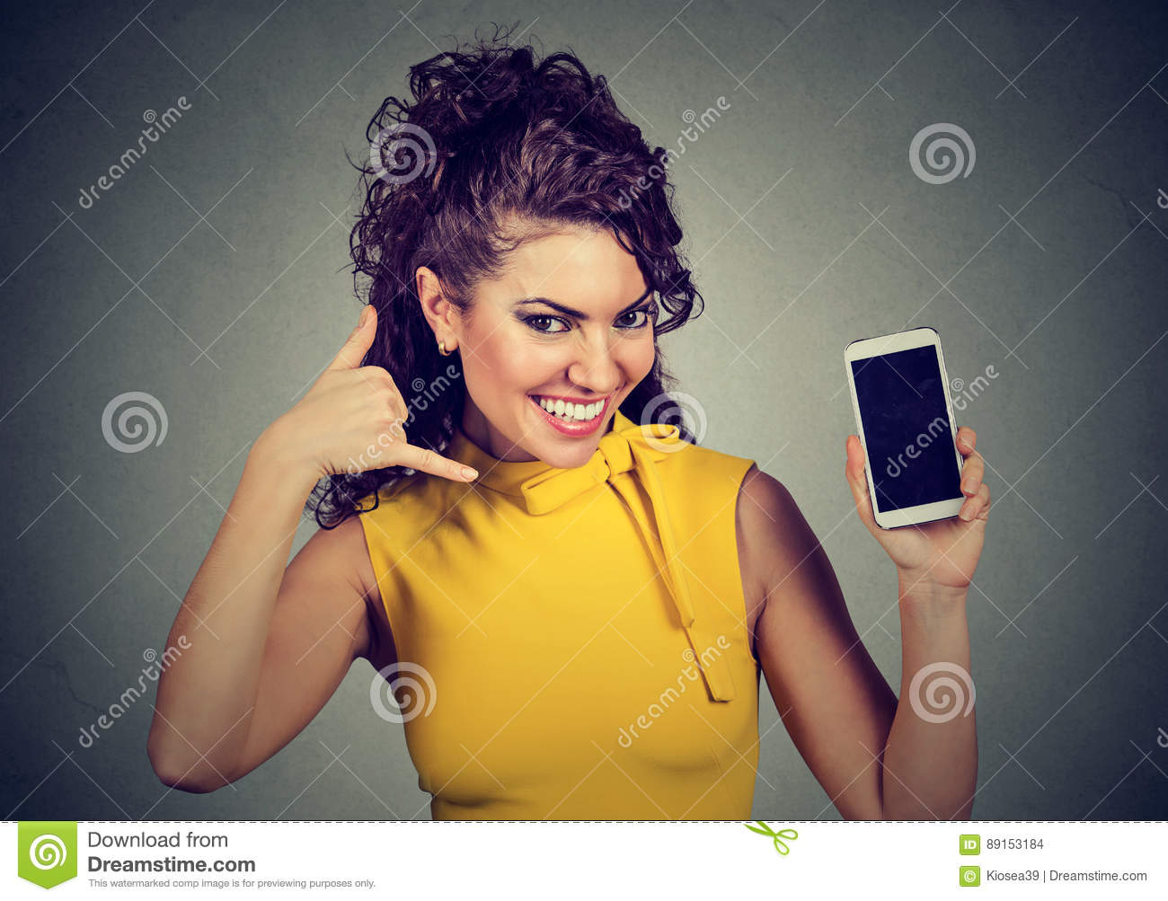 Pretty woman holding mobile phone showing call me hand gesture