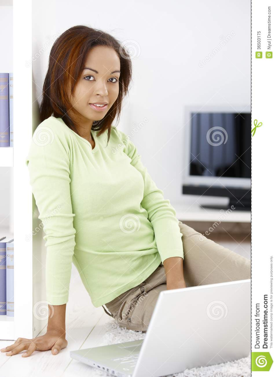 Pretty woman with laptop at home