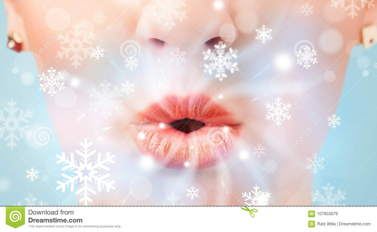 Pretty woman mouth blowing cold breeze