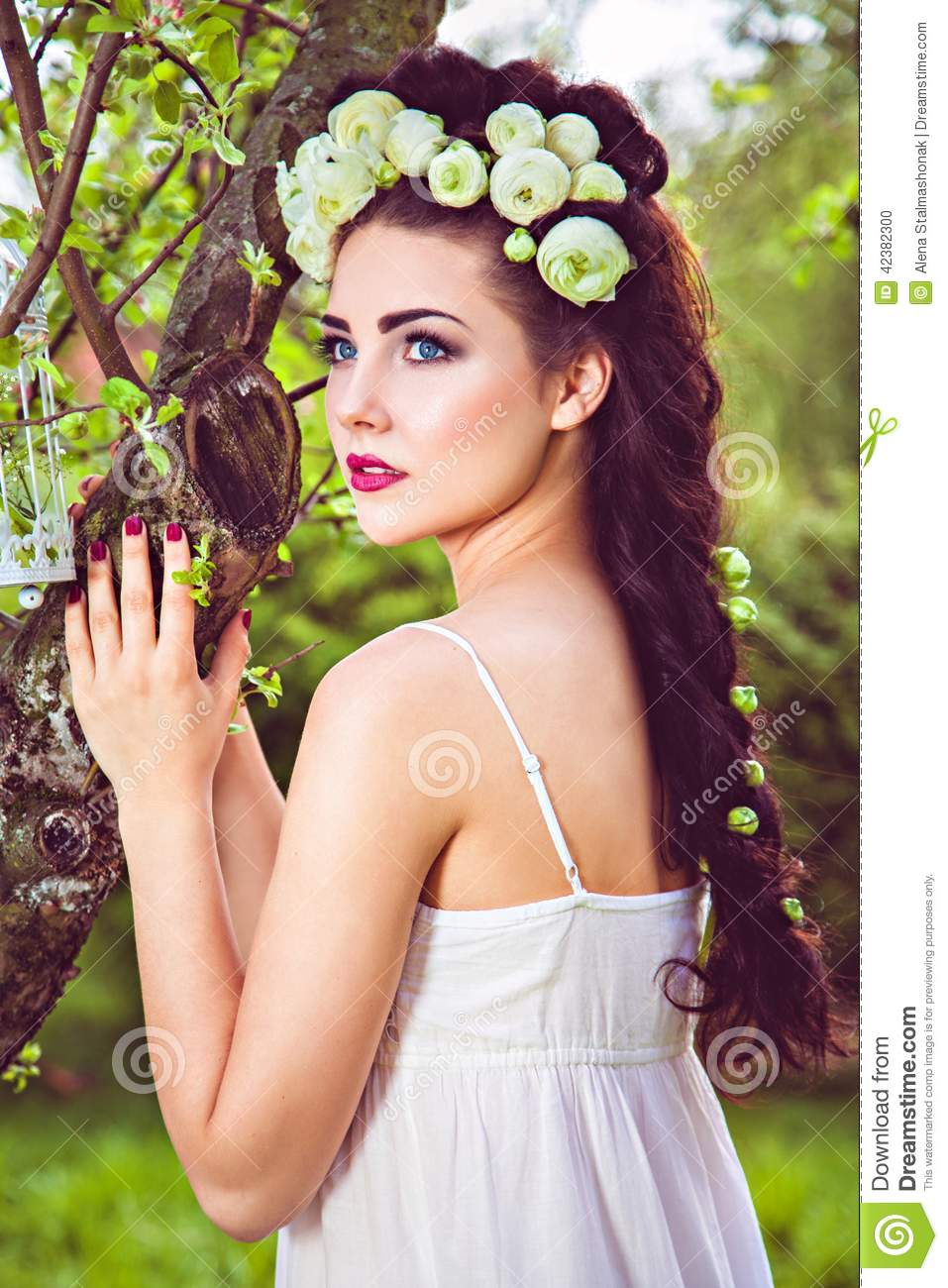 Pretty woman with natural white flowers in hair stock photo image pretty woman with natural white flowers in hair mightylinksfo