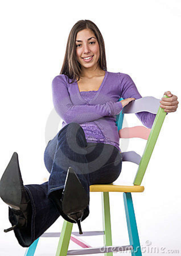 Pretty Woman Sitting On A Colorful Chair Royalty Free ...