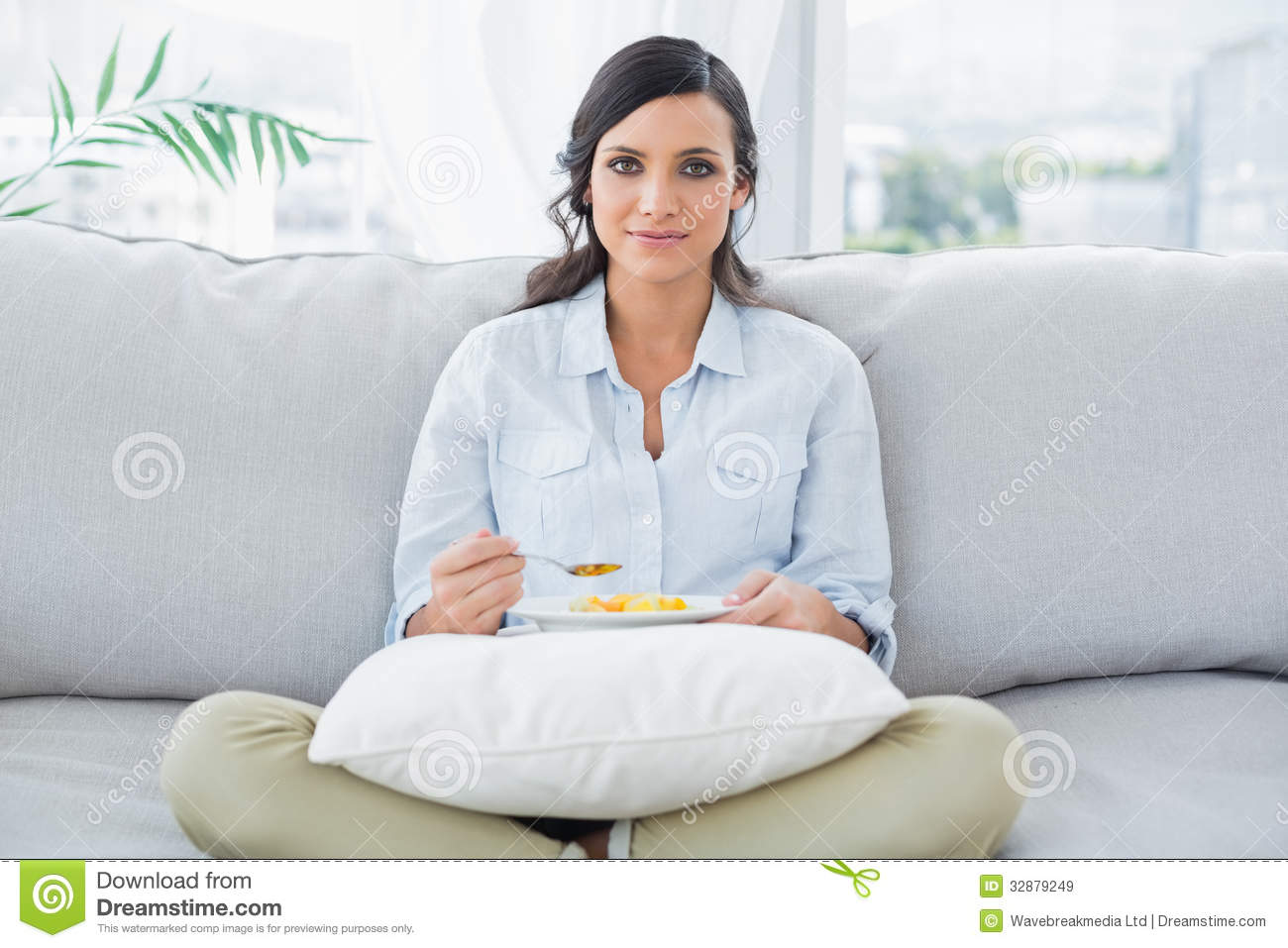Pretty Woman Sitting On The Couch Crossing Legs Royalty Free Stock Images - Image -7897