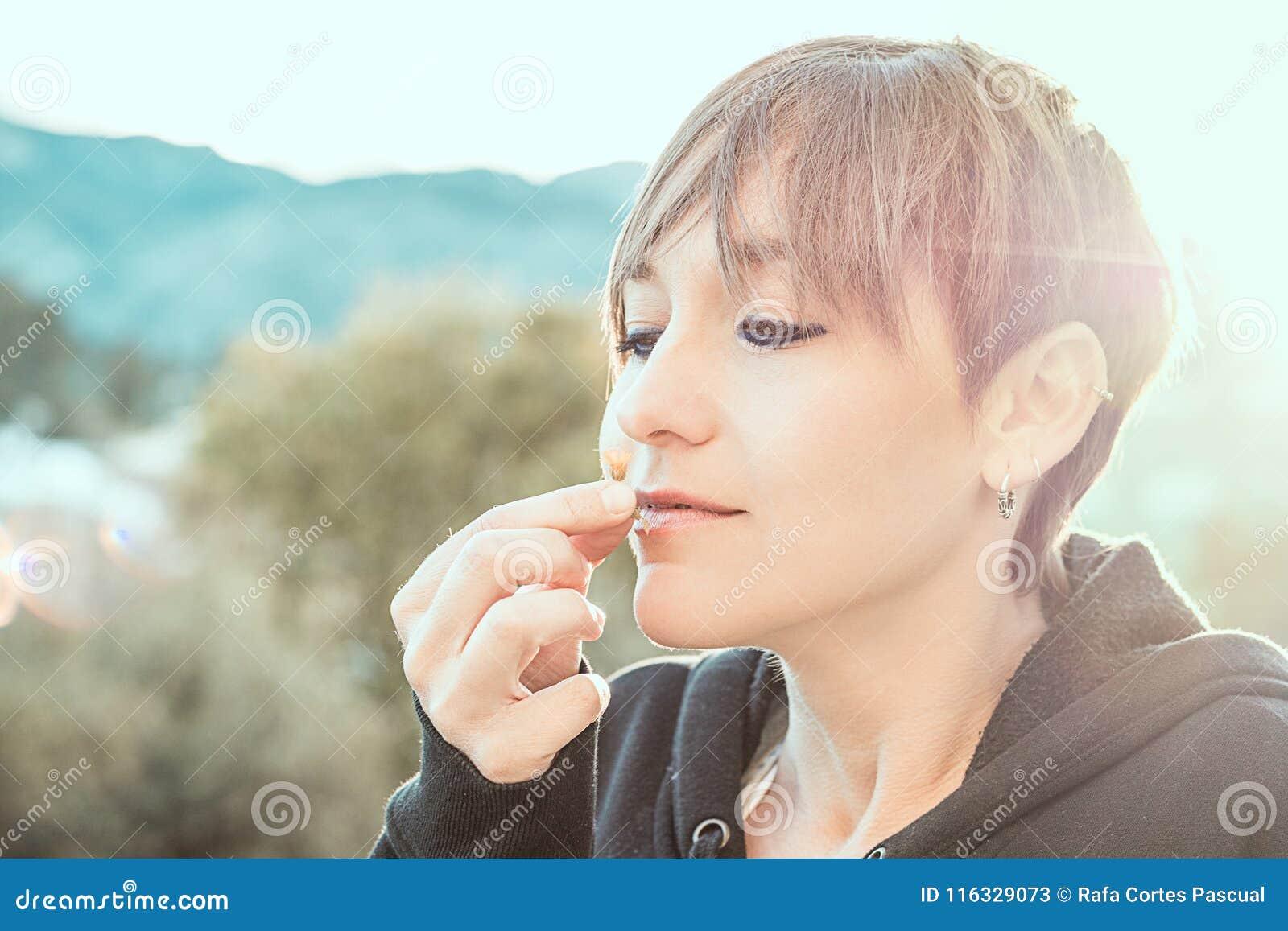 Pretty woman smelling a flower