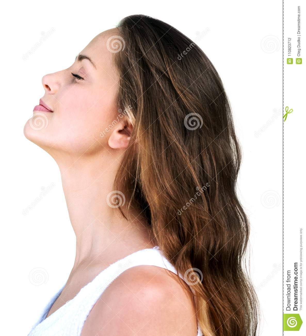 Pretty woman smiling, side view, isolated on white