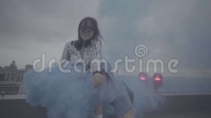 Pretty woman with smoke bomb over city background  Slow motion, s-log,  ungraded