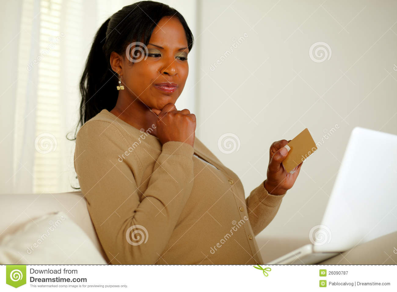 Pretty woman thinking buy online with credit card