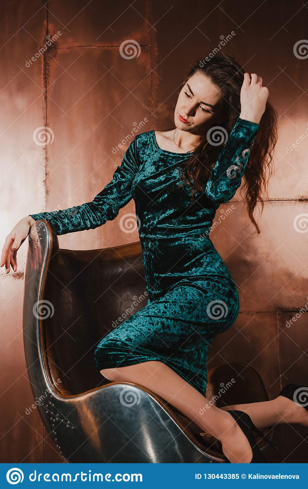 Pretty Woman In A Velvet Dress Sitting In A Leather Chair Luxury