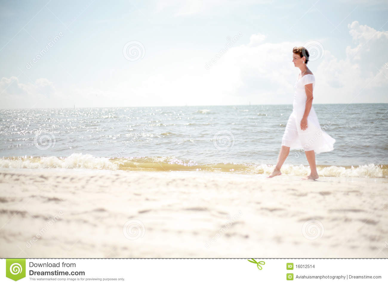 Woman walking on a beach royalty - Pretty Woman Walking The Beach Royalty Free Stock Photo