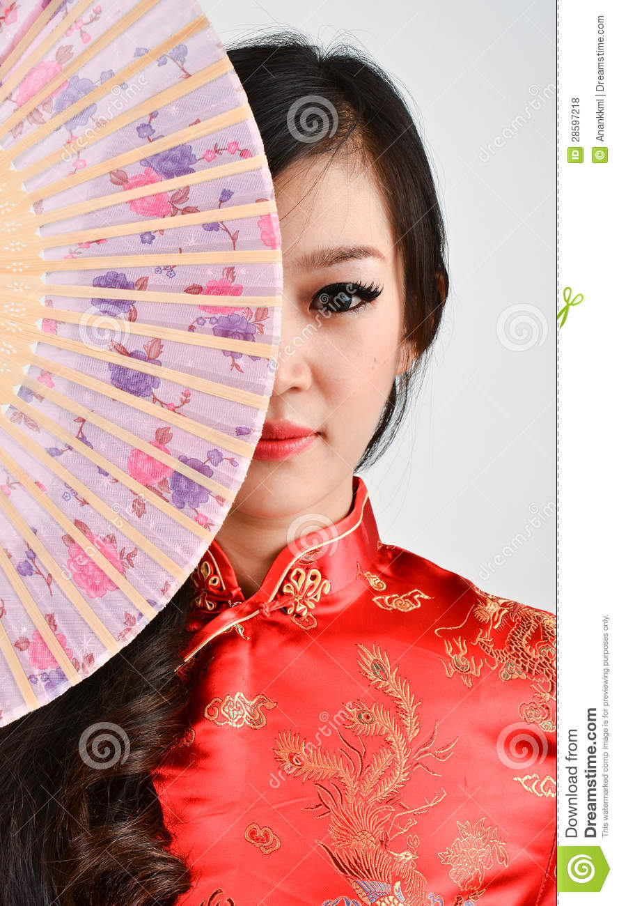 fc91a255d Pretty woman with Chinese traditional dress Cheongsam and hole Chinese Fan  on gray background