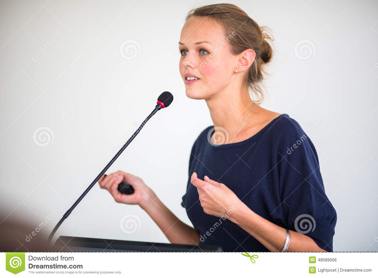 pretty-young-business-woman-giving-presentation-conference-meeting-setting-shallow-dof-color-toned-image-48589566.jpg