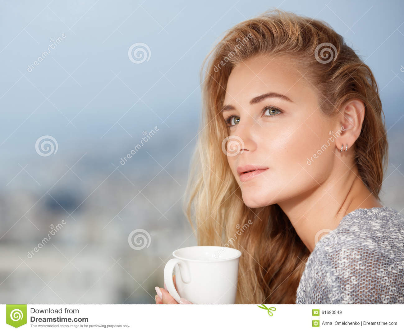 Pretty young female drinks tea
