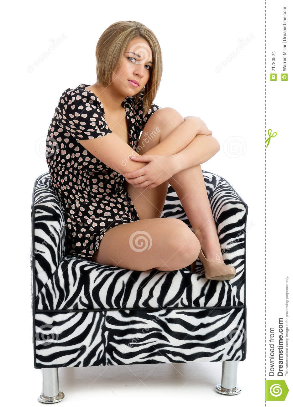 Pretty young female isolated posing in chair