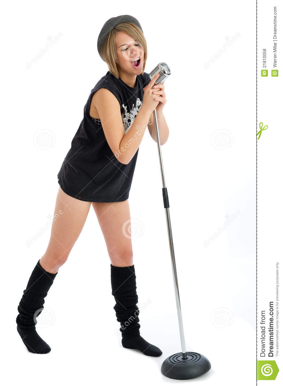 Pretty young female singer with retro microphone
