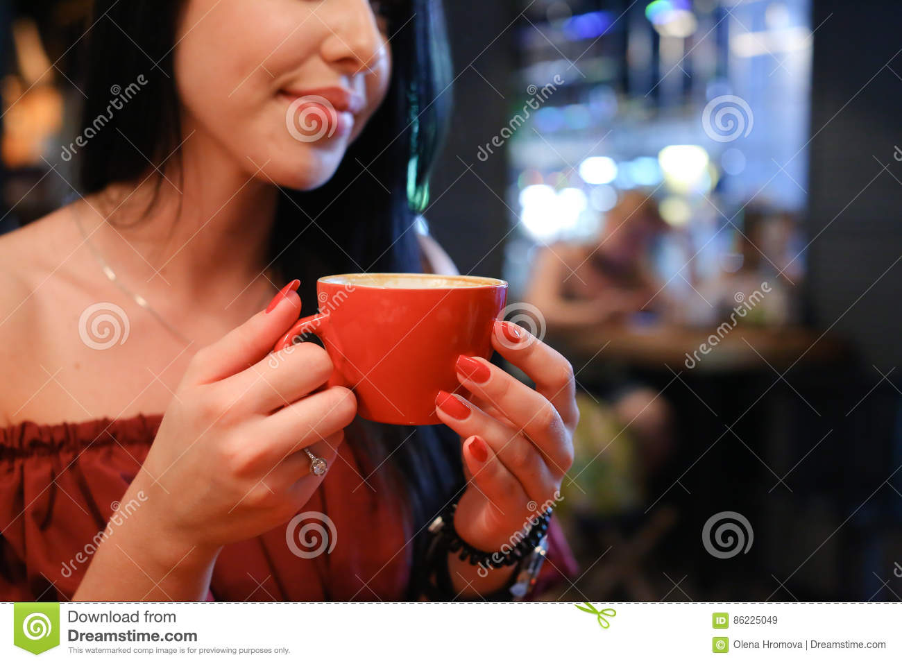 Pretty young female woman holds in hand cup and drinks coffee ag