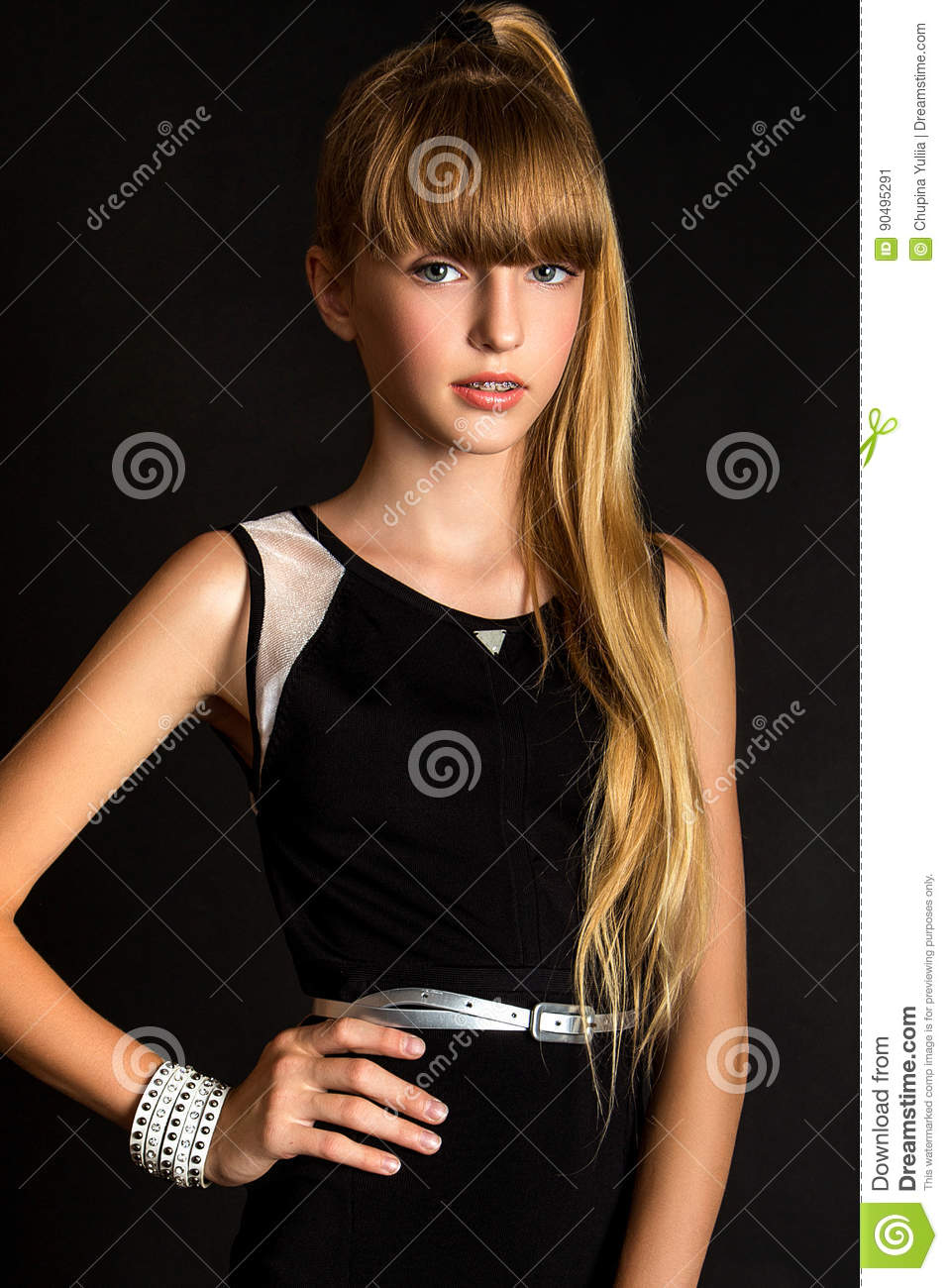 Pretty Girls That Make The World A Little More Beautiful: A Pretty Young Girl On The Black Background Stock Image