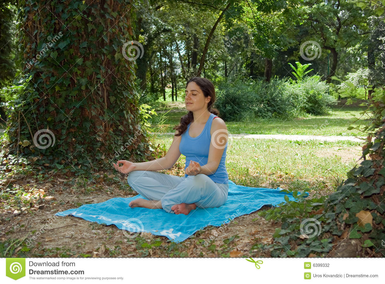 Pretty young girl meditating outside on grass stock photo for Pretty grass
