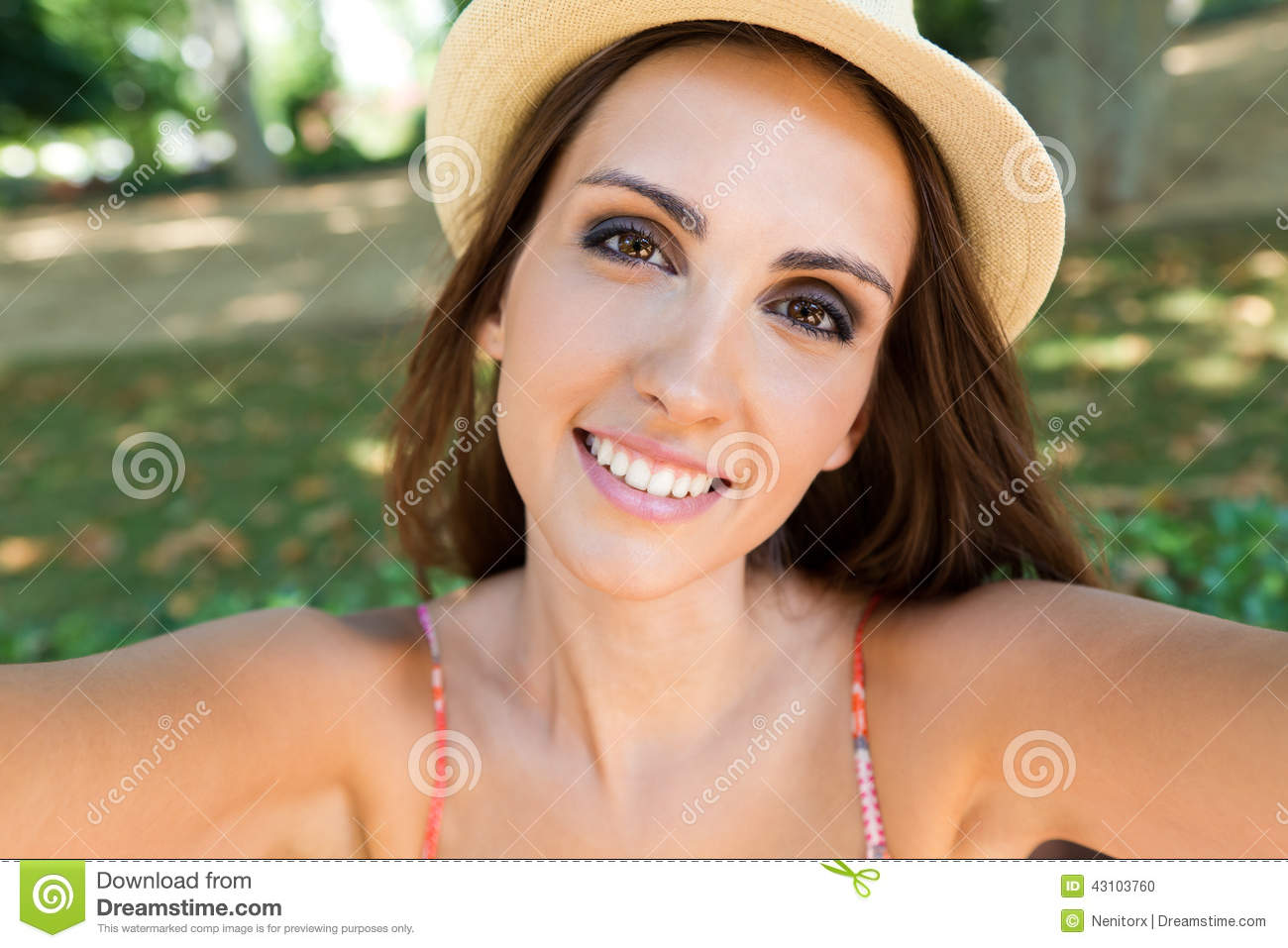 Portrait of pretty young girl taking selfies with her smart phone in ...