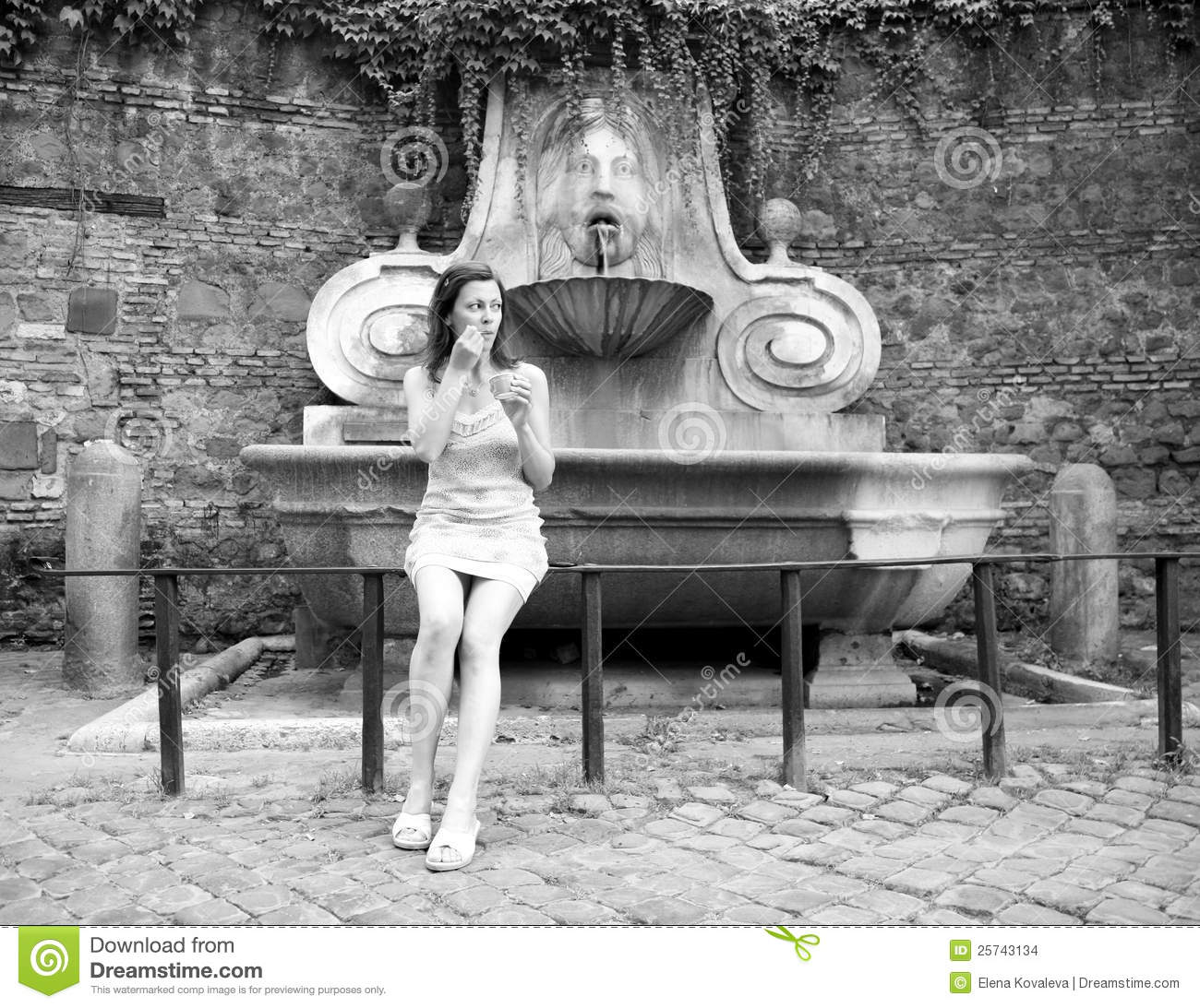 Pretty young tourist woman with ice cream Rome