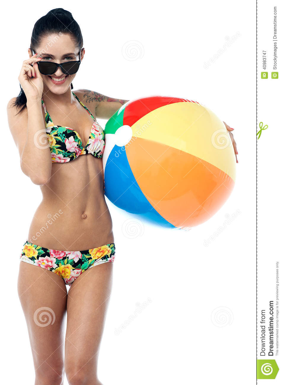 Smiling Woman Holding A Beach Ball And Sunglasses Royalty ...