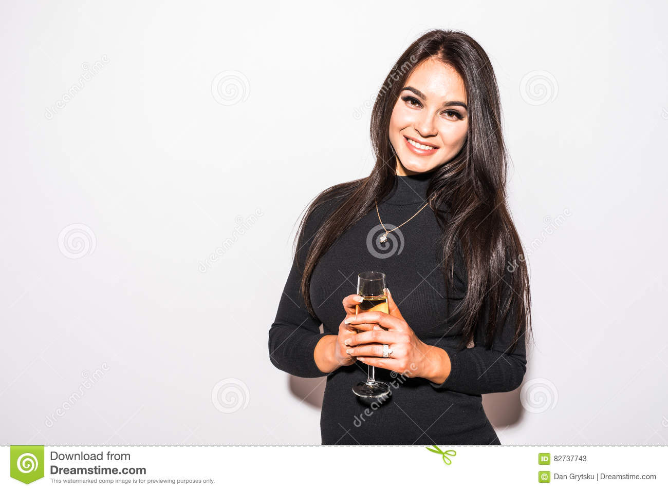 426d746c411f Pretty young woman in black dress drinking champagne over white background