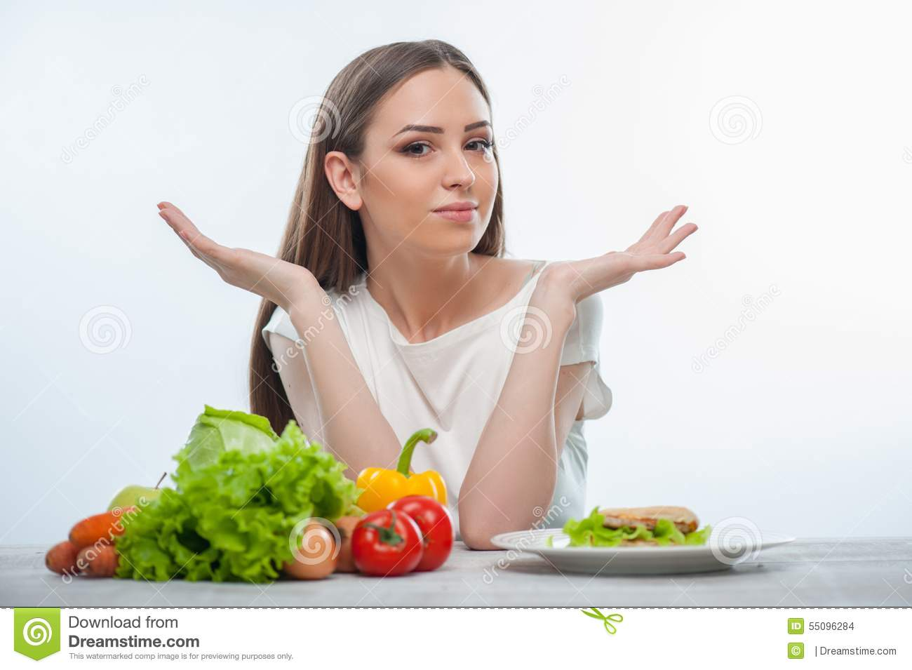 Pretty young woman does not know what to eat