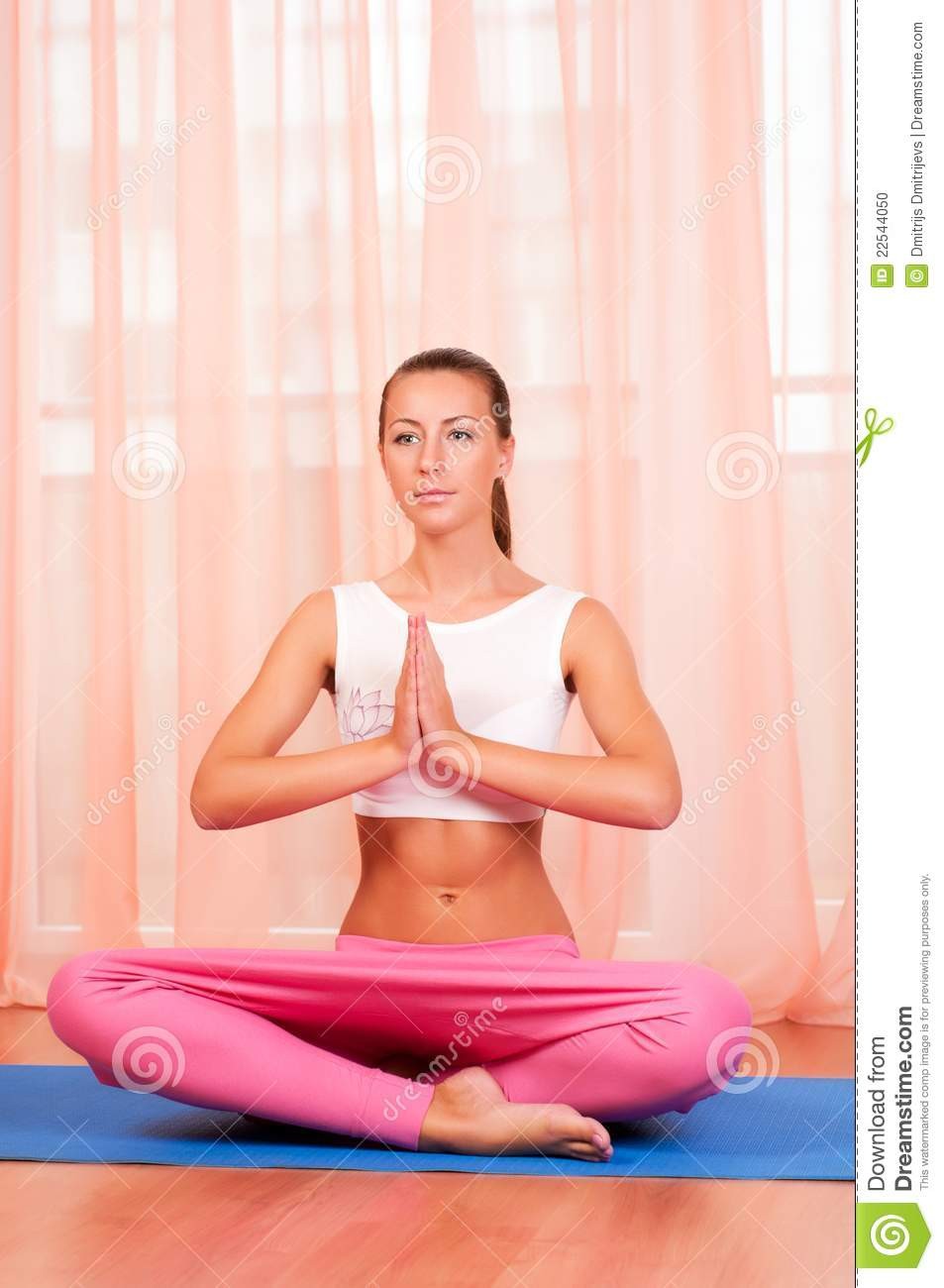 Pretty Young Woman Doing Yoga Exercise On Mat Royalty Free