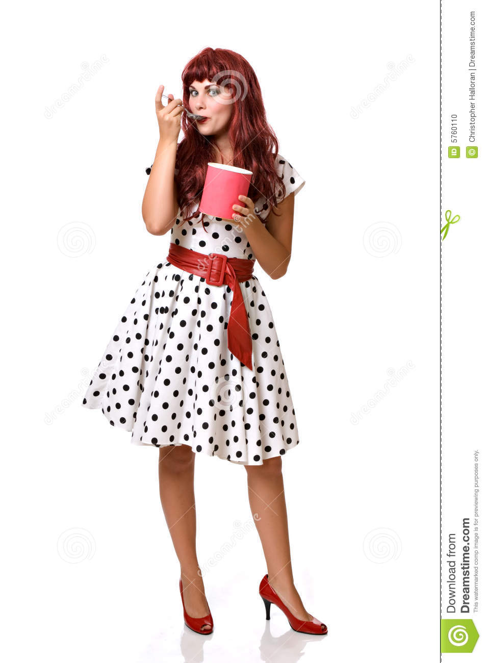 Pretty young woman eating ice cream