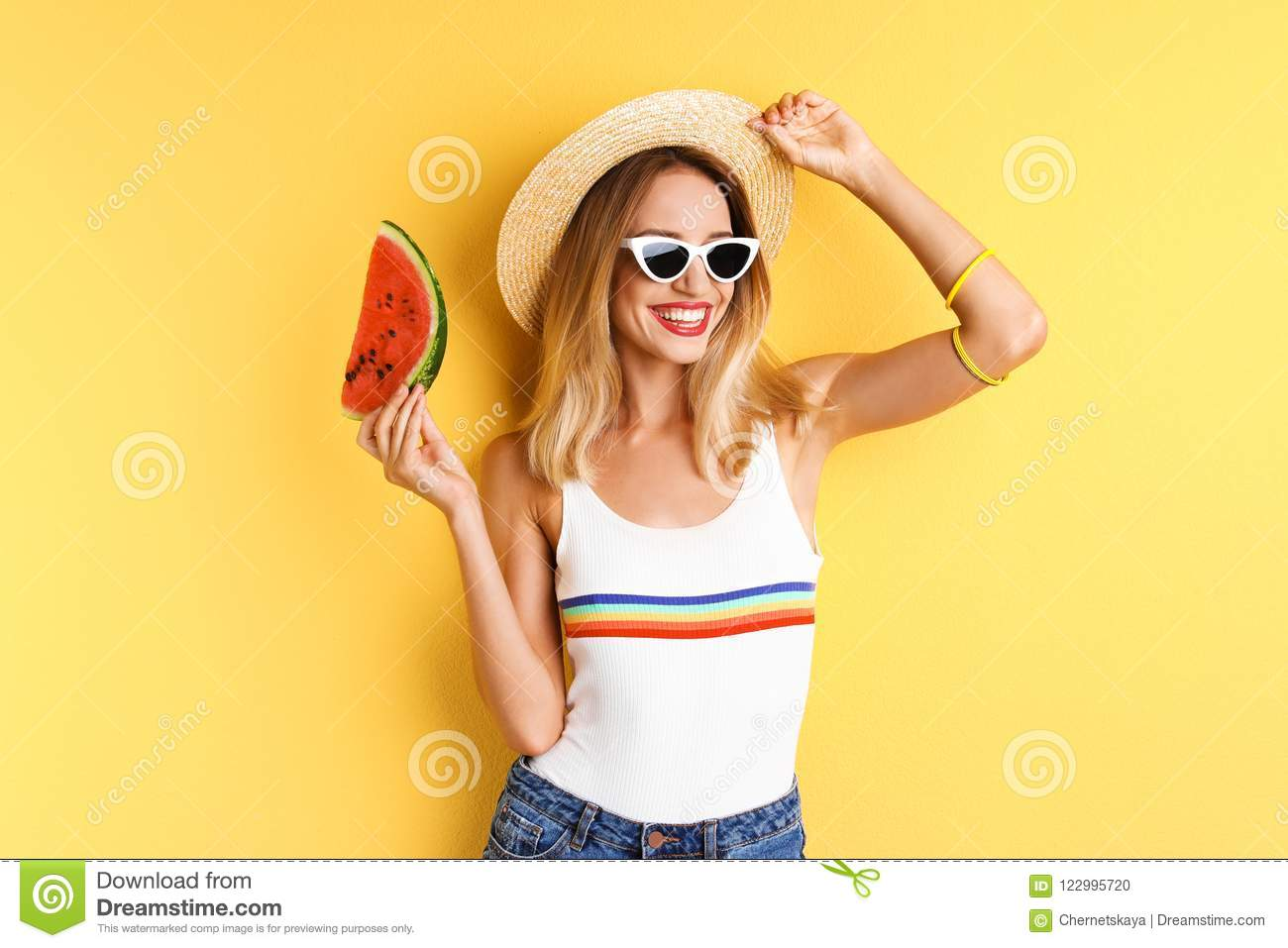 Pretty young woman with juicy watermelon