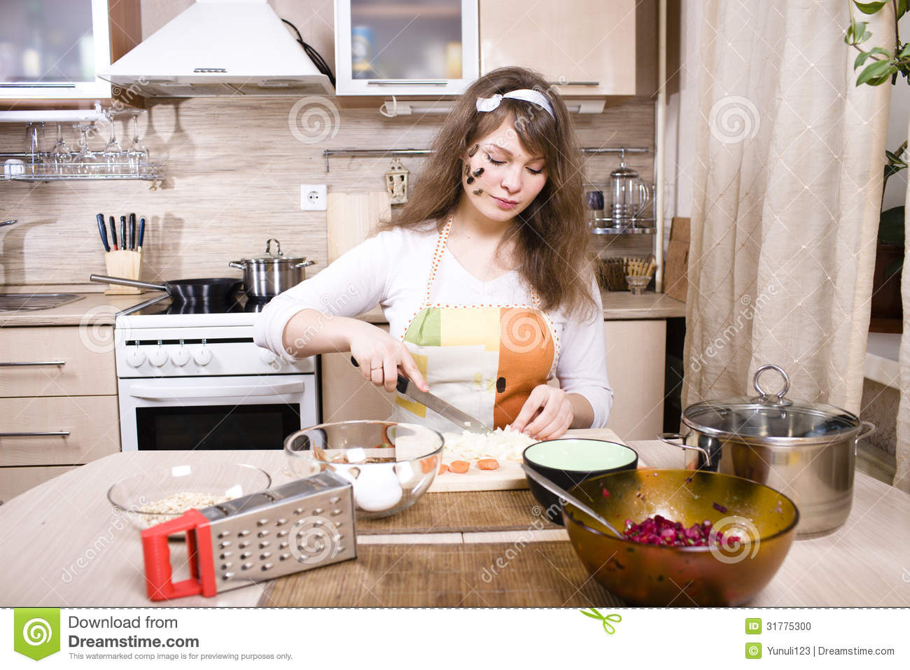Pretty young woman on kitchen preparing dinner stock photo image