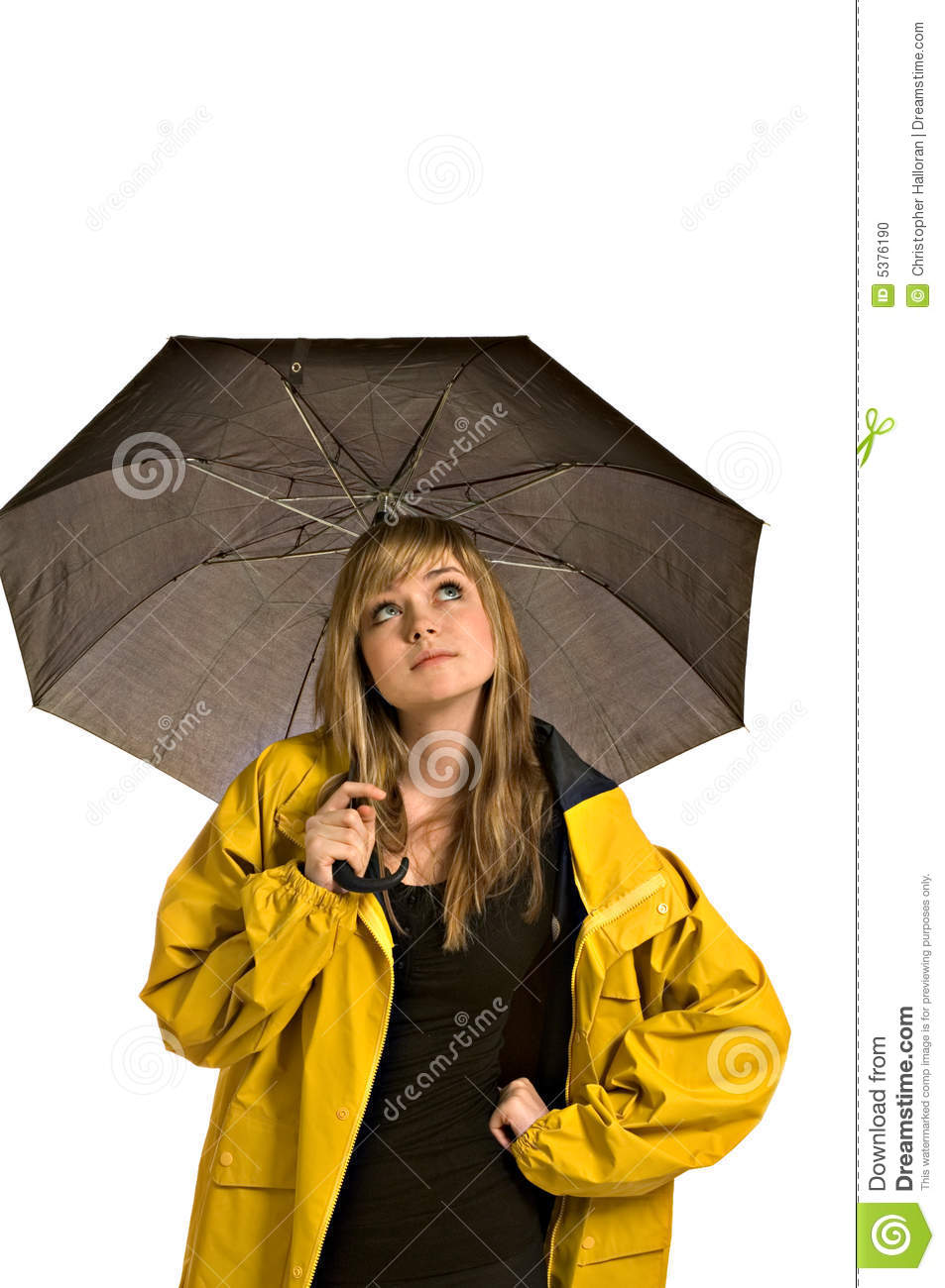 Pretty young woman in a raincoat with umbrella