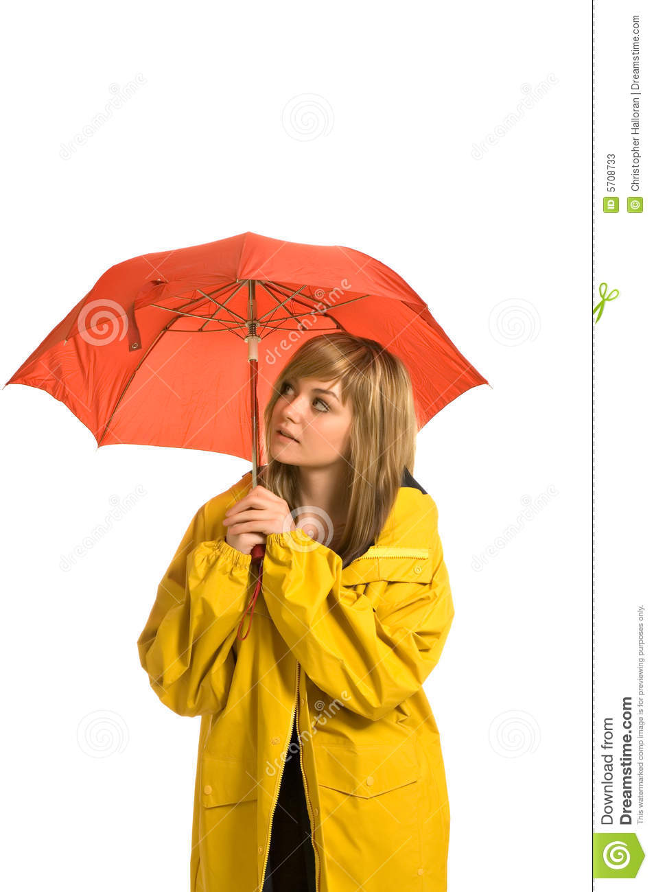 Pretty young woman in raincoat with umbrella
