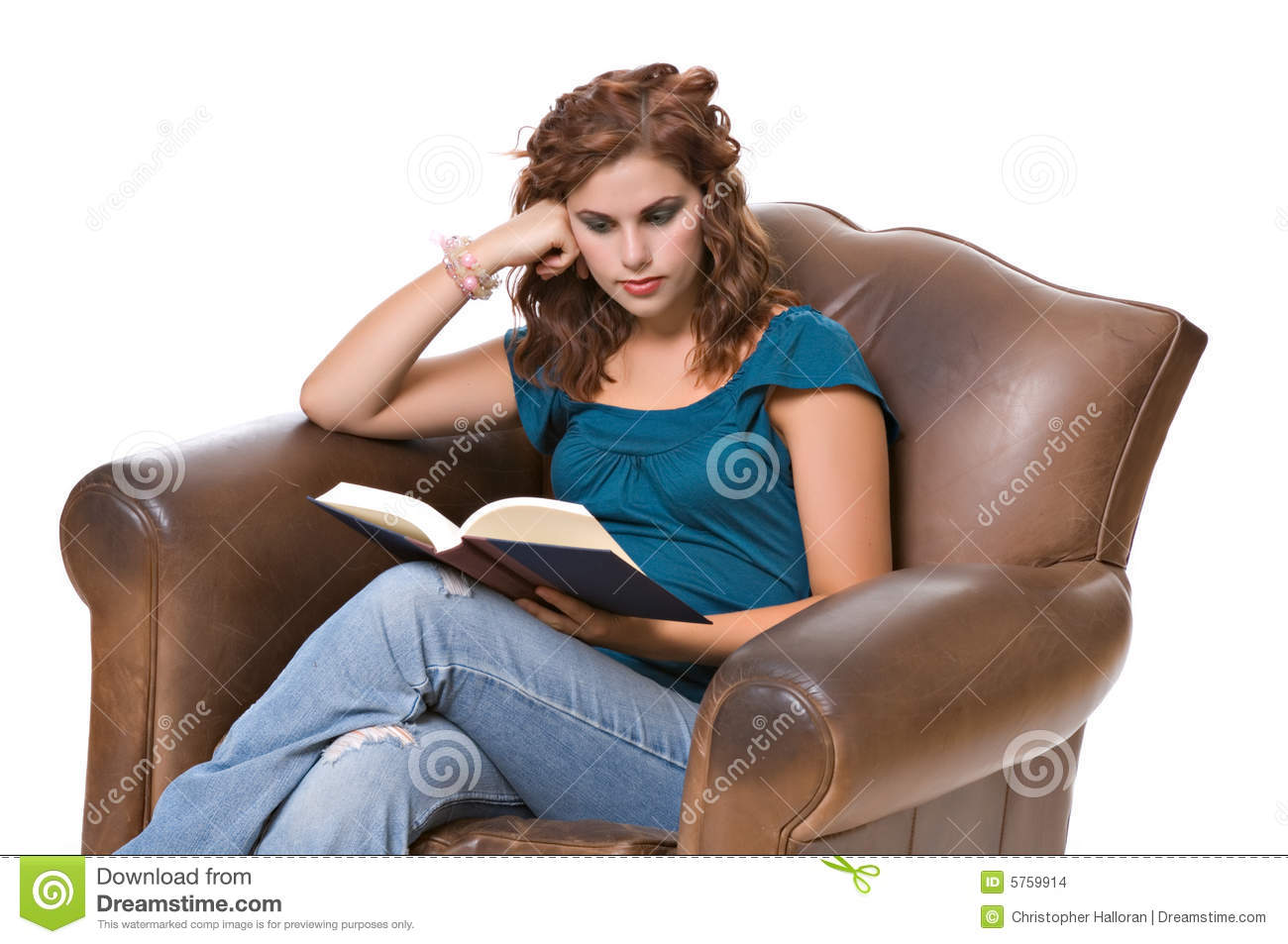 Pretty young woman reading book