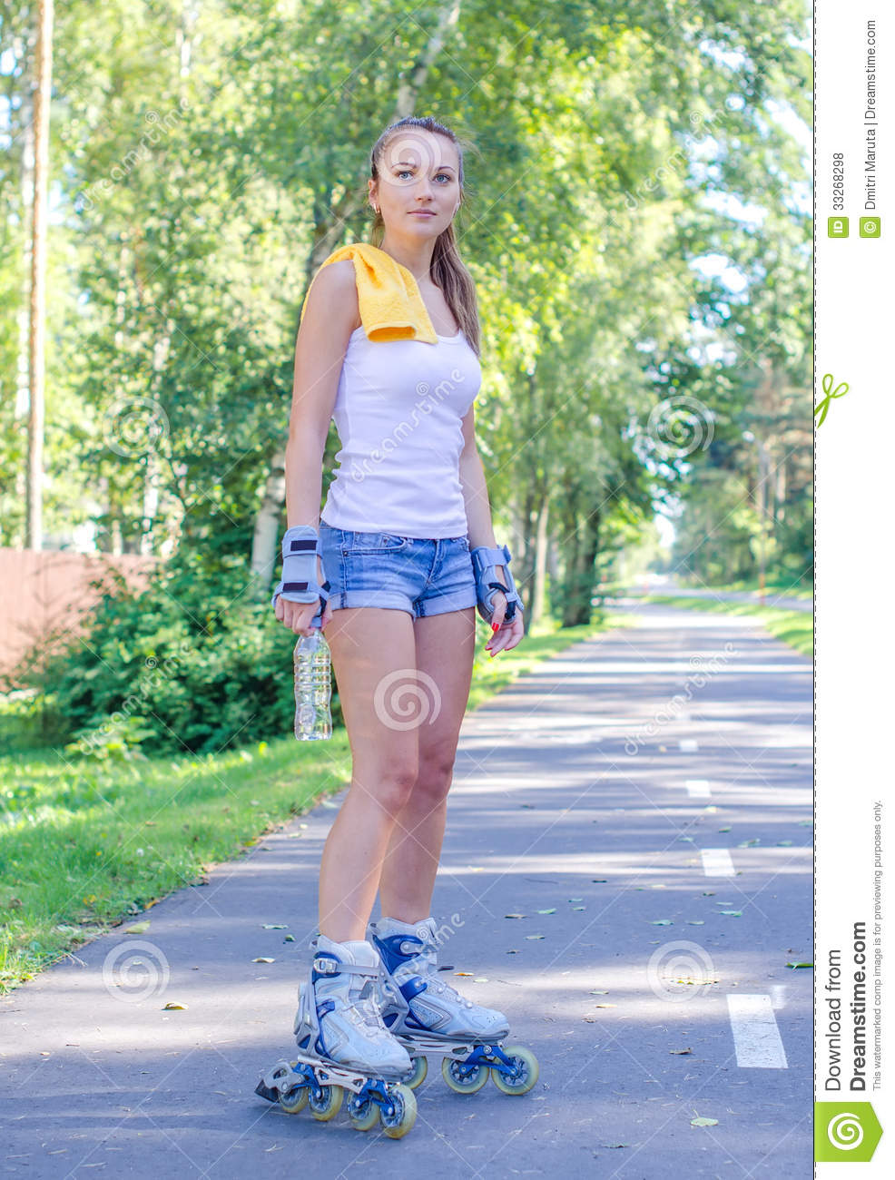 Pretty Young Woman On Roller Skates Royalty Free Stock ...