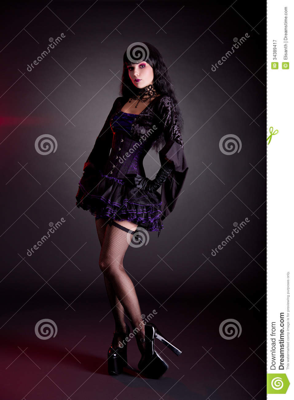 Pretty young woman in Victorian purple and black Halloween outfit