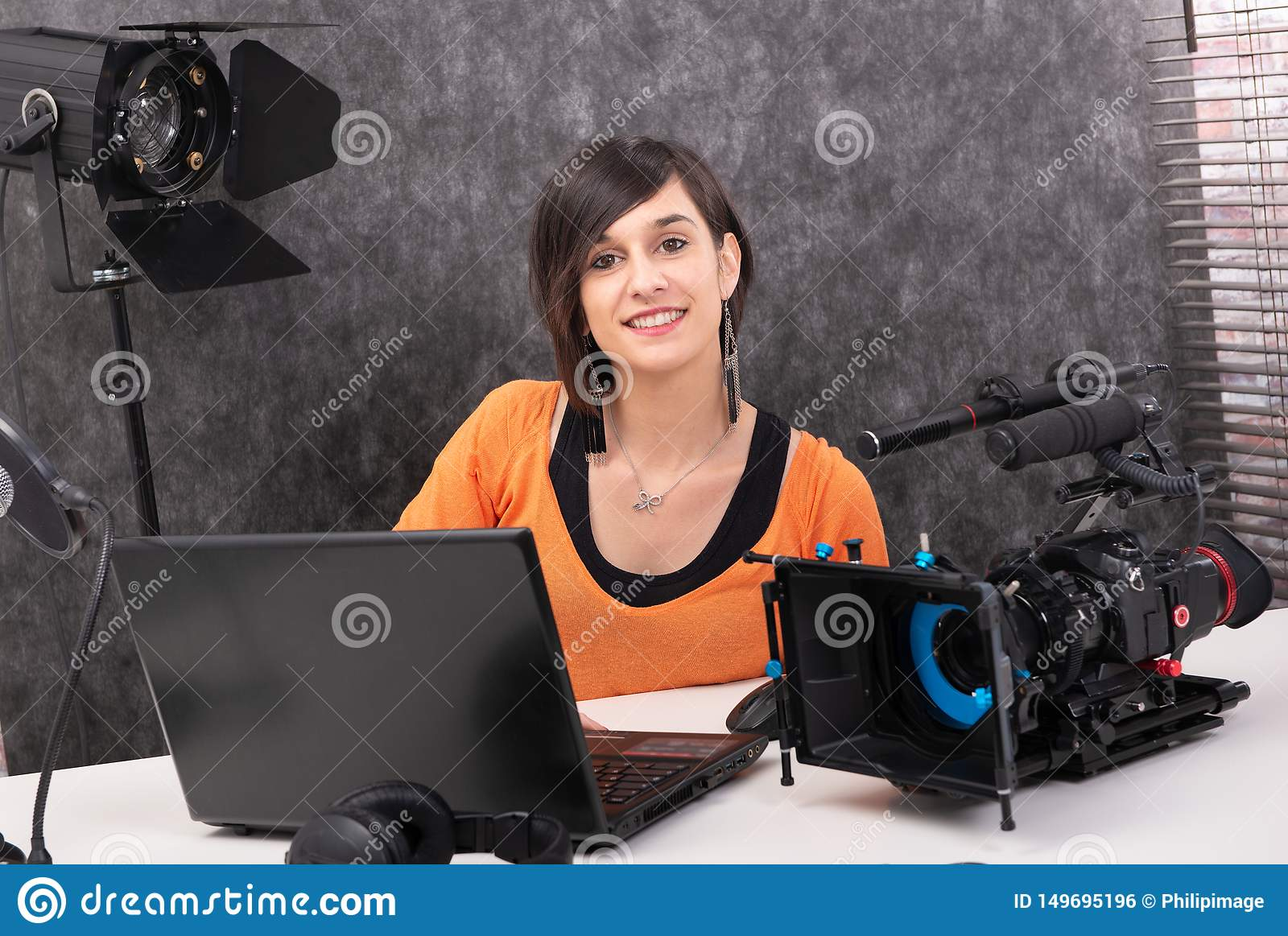 Young woman video editor working in studio