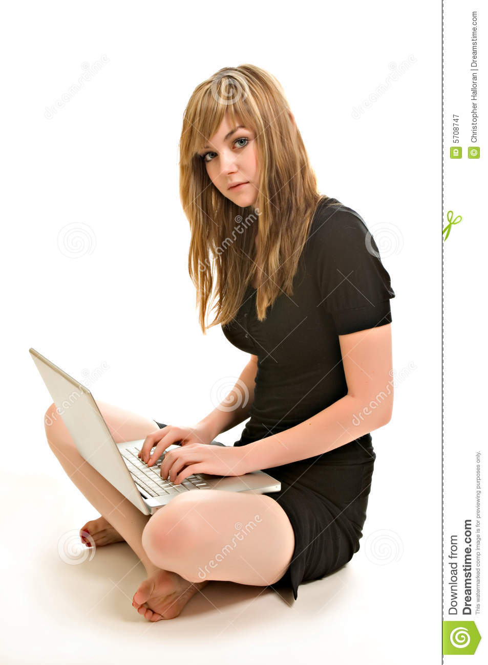 A pretty young woman working on a laptop
