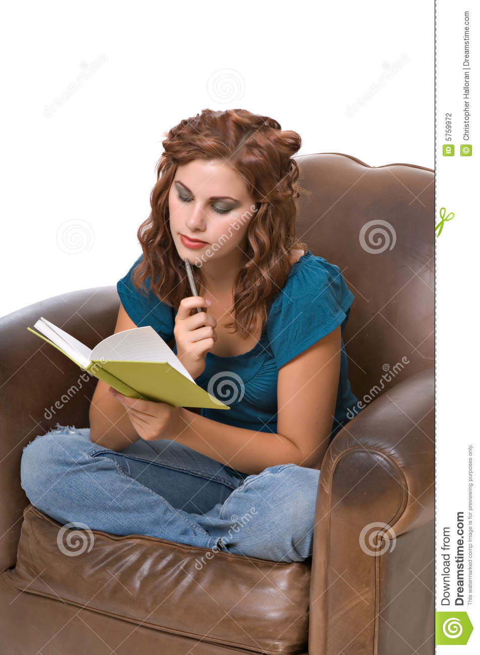 Pretty young woman writing