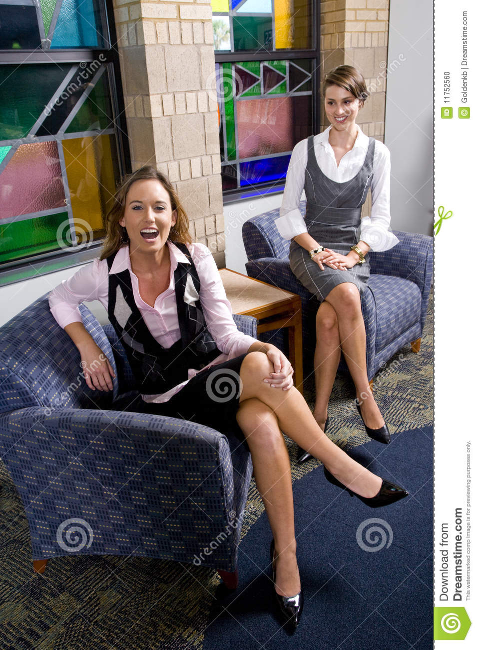 Pretty young women sitting on waiting room chair