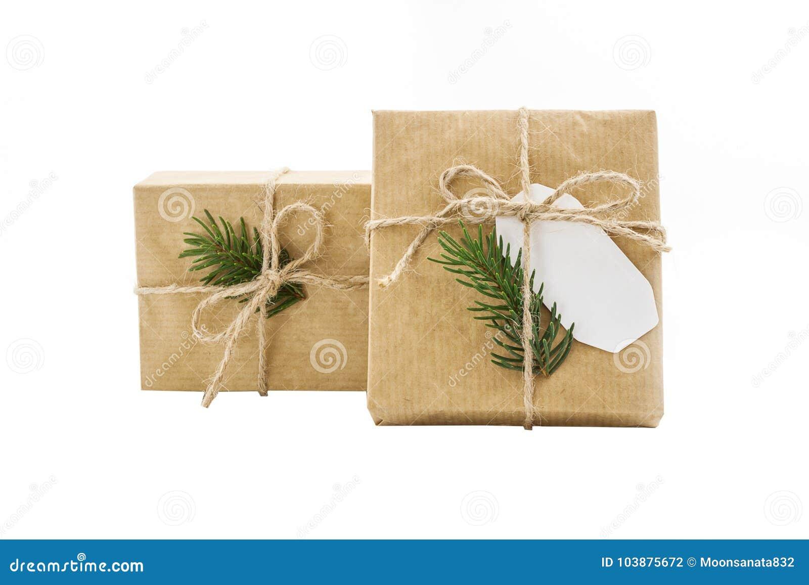 Prezenta pudełka rzemiosła zawijający papier na odosobnienia tle