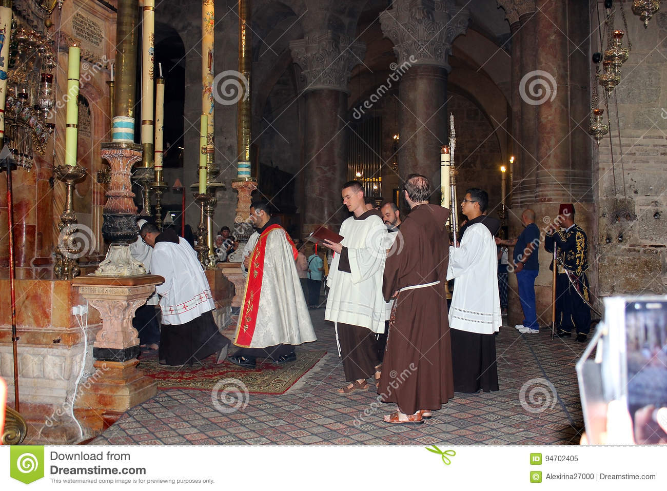 Priests at the entrance to the aedicula of the Holy Sepulchre, Jerusalem