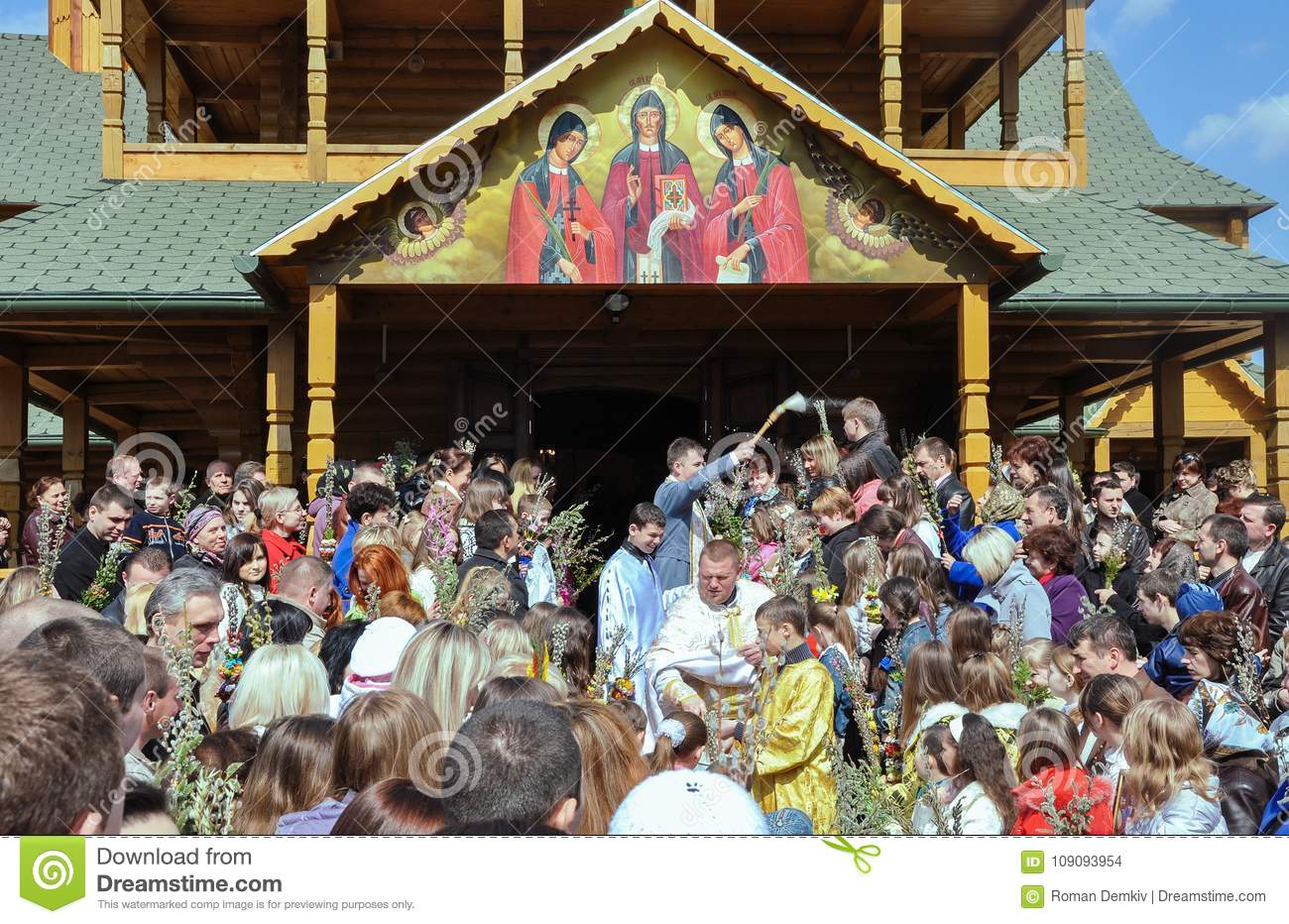 Drohobych, Ukraine - April 17, 2011: Priests sanctify the willow branches, people in the service of God, eve of Easter, Willow Sun
