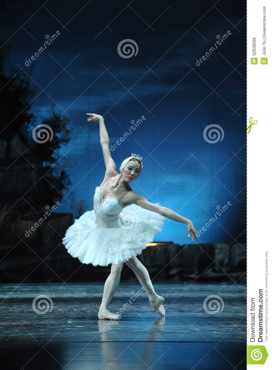Prima ballerina staring at the reflection in water editorial stock