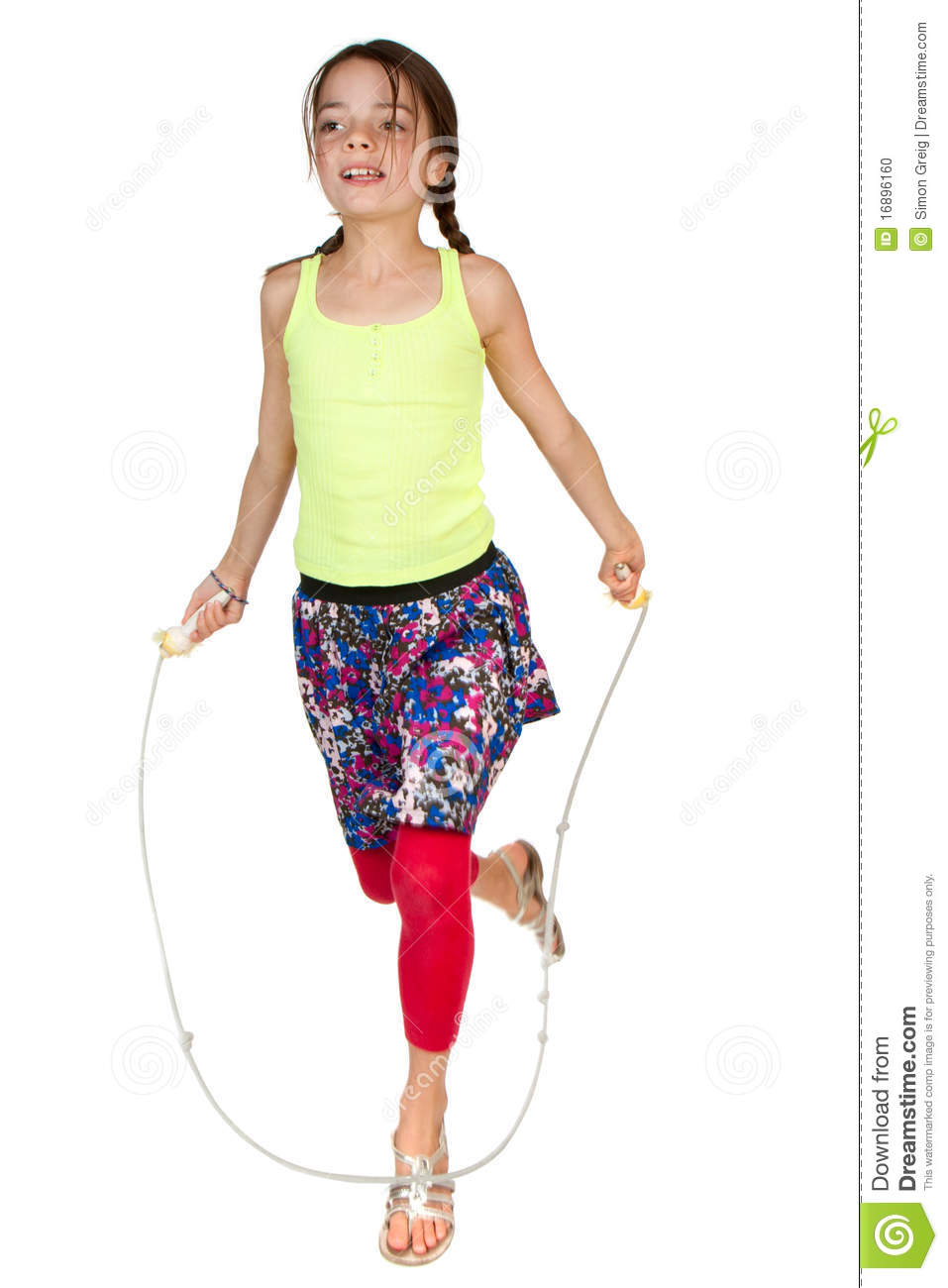 Primary Age Girl Skipping Stock Photo - Image: 16896160