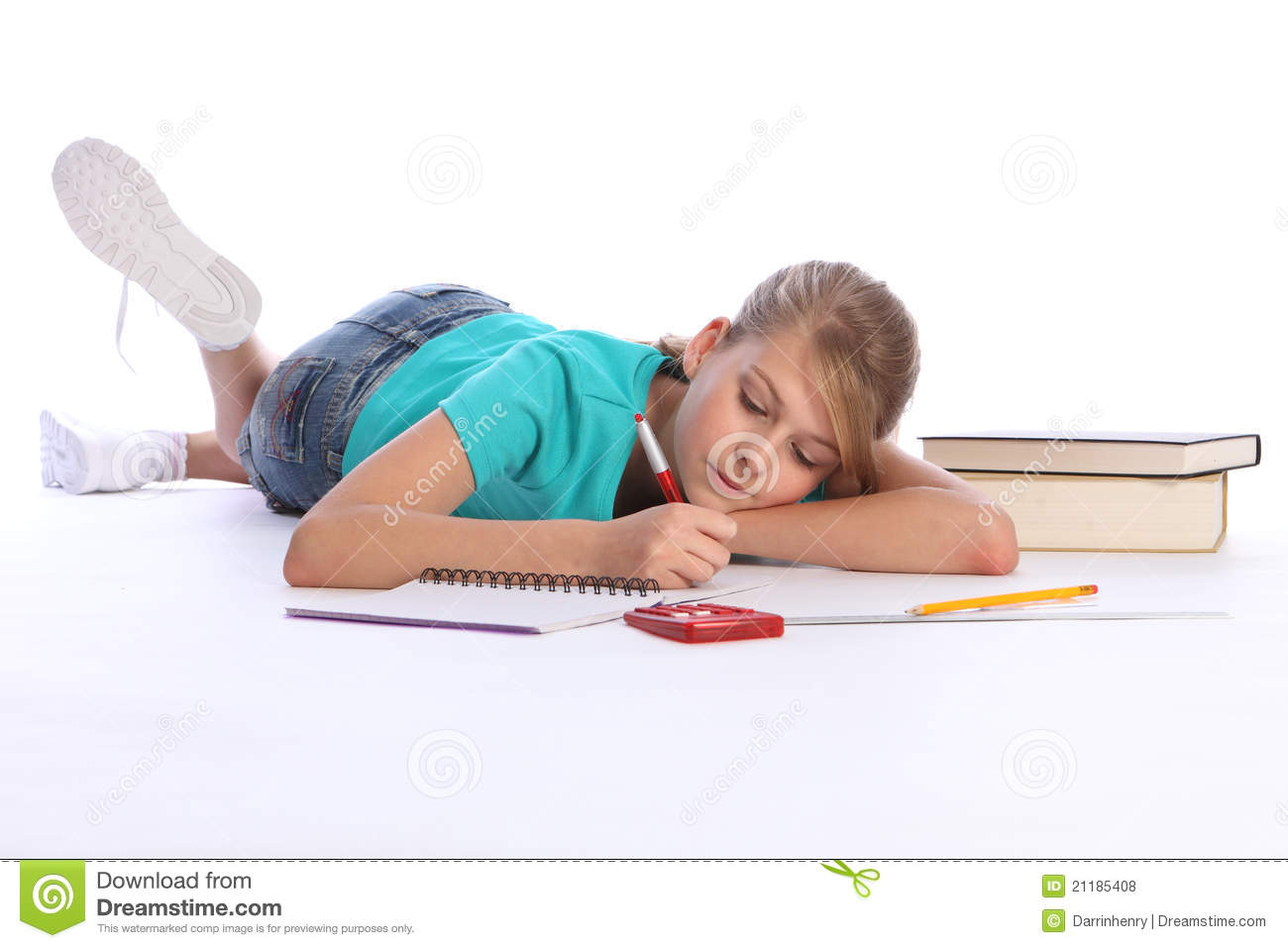 Primary school girl doing math homework on floor royalty for Floor calculator math