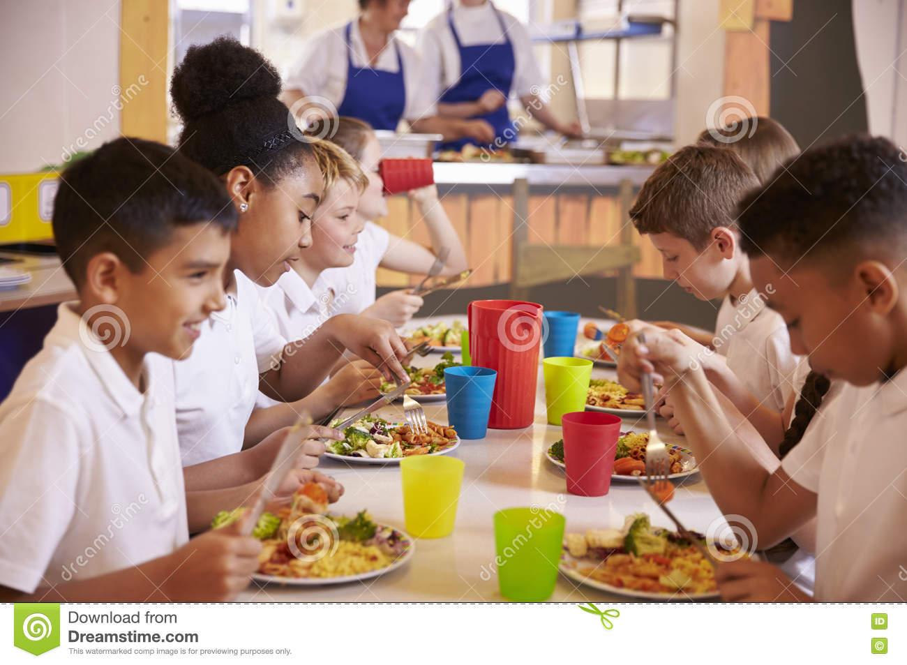 Eating Table Primary School Kids Eating At A Table In School Cafeteria Stock