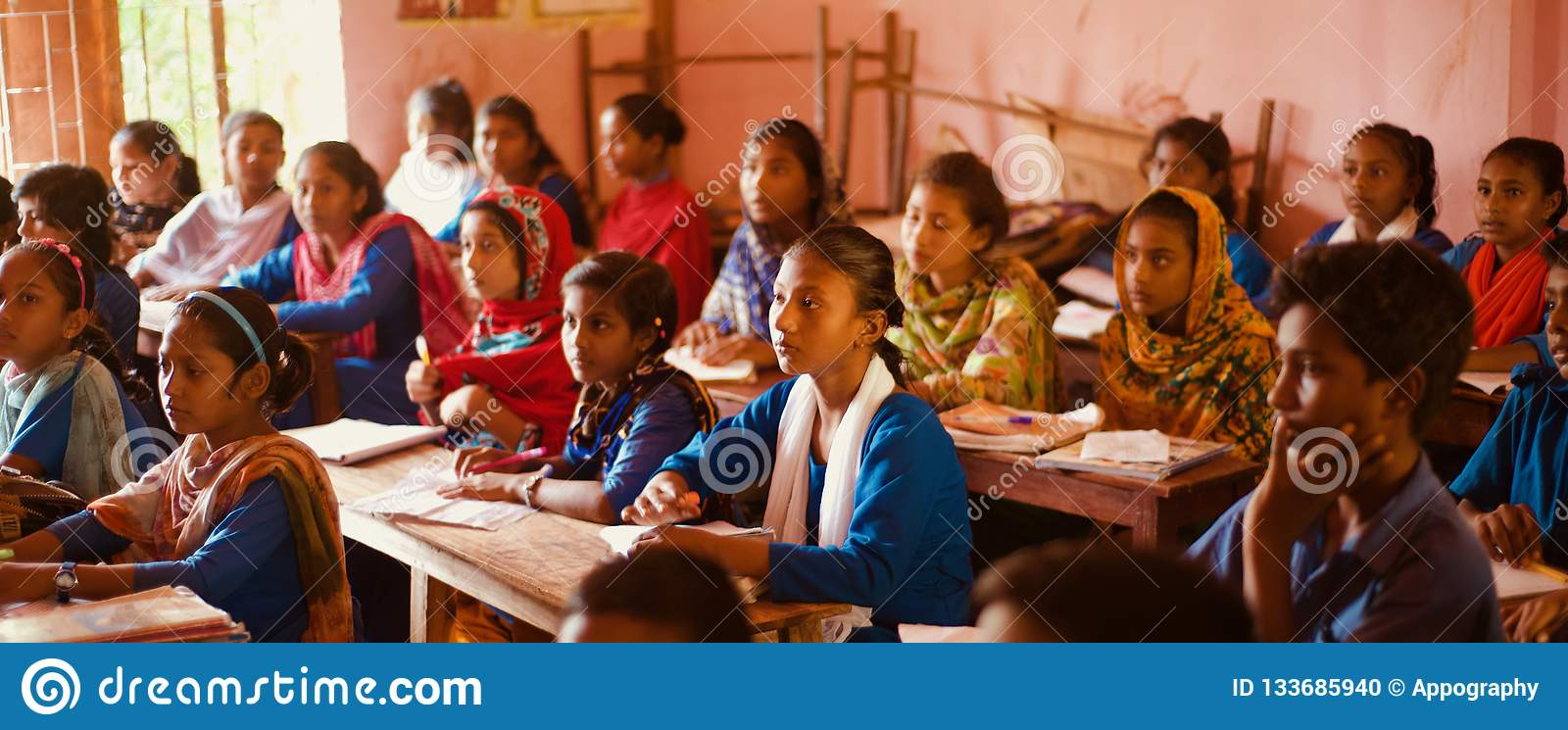 Primary students sitting around a classroom