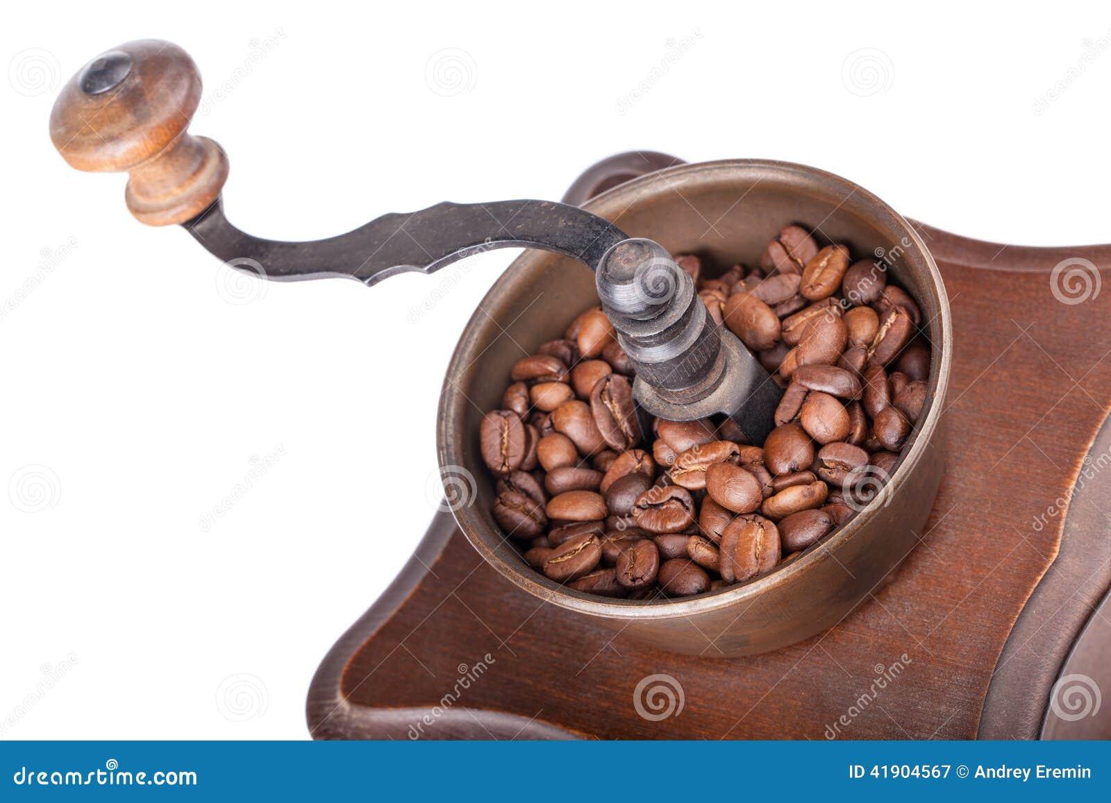 Primer de la amoladora de café con café