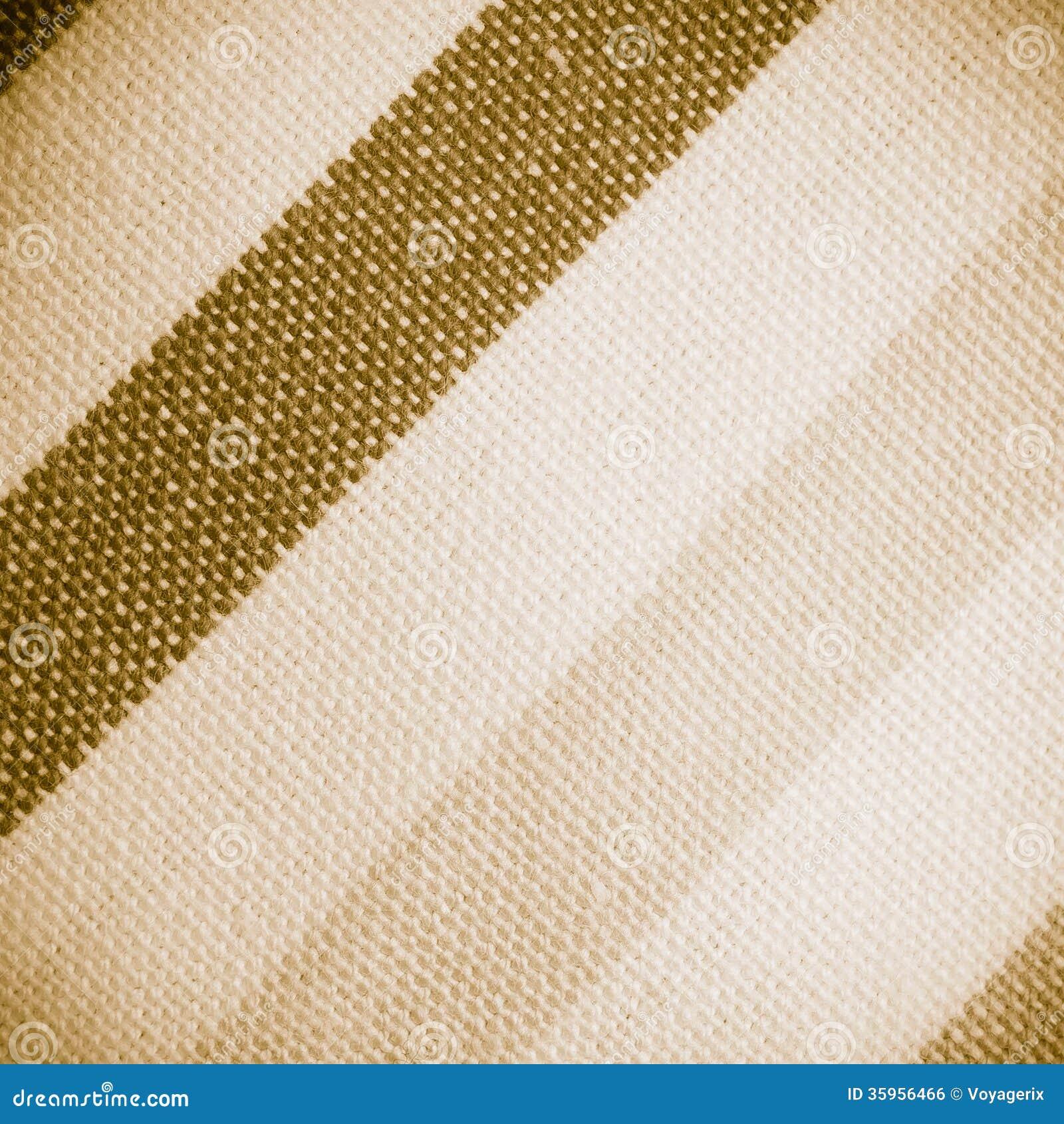 Primer de la materia textil rayada colorida como fondo o textura